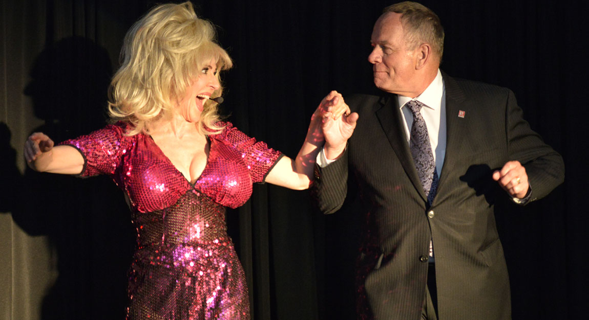Dolly Parton Impersonator Tracey Bell performing at a corporate event
